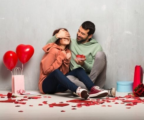 couple-valentine-day-holding-gift-box_1368-27351