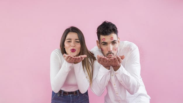 young-couple-blowing-kisses-